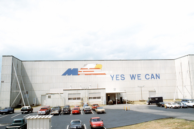 "A view of the base motto, ""Yes We Can"", and the Military Airlift Command (MAC) logo painted on hangar 250"