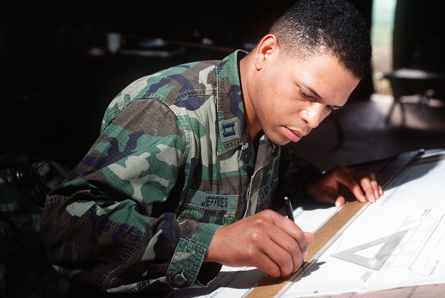 CAPT. Jeffries, an engineer with the 554th Civil Engineering Squadron RED HORSE (rapid engineer deployable, heavy operational repair squadron, engineer) designs a boathouse for the Marine Corps detachment on the island during Exercise Horsepower '92