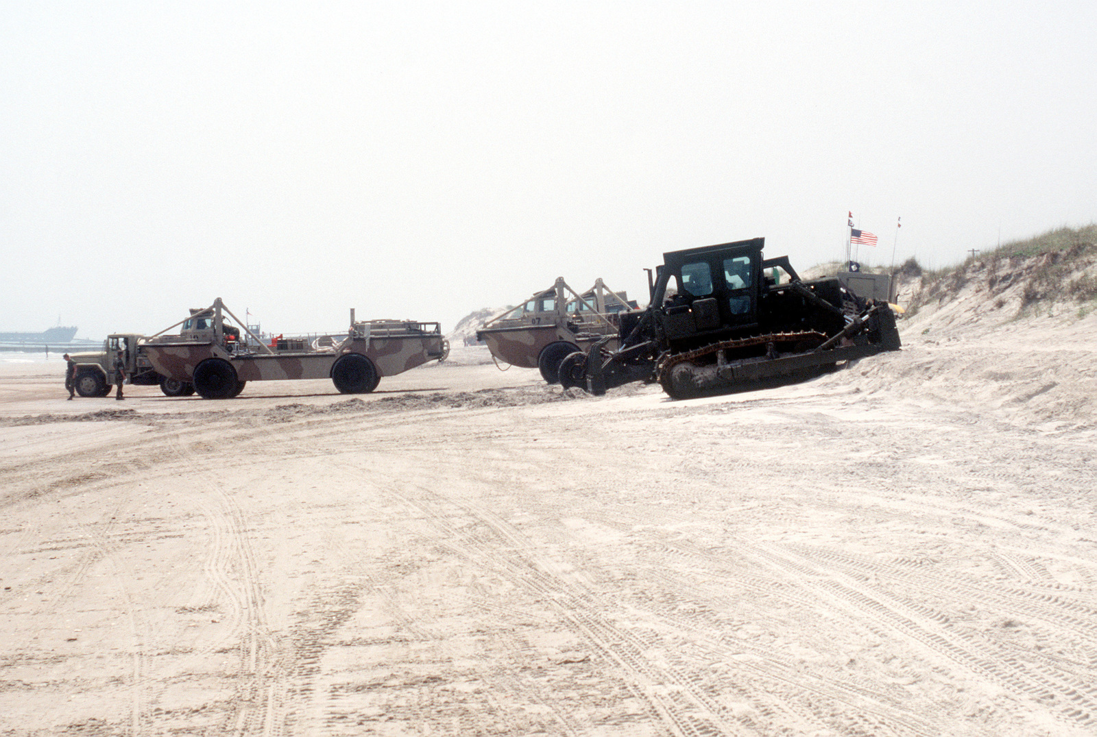 LARC-5 amphibious cargo carriers and other equipment are positioned