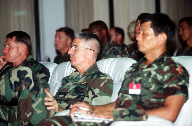 MAJ. GEN. Norman E. Ehlert, commanding general, III Marine Expeditionary Force (III MEF), listens to a daily assessment briefing during the joint Thai-U.S. training exercise Cobra Gold '92. Ehlert is serving as the deputy commander, Combined Joint Task Force and commander, U.S. Joint Task Force, Cobra Gold 92, during the exercise