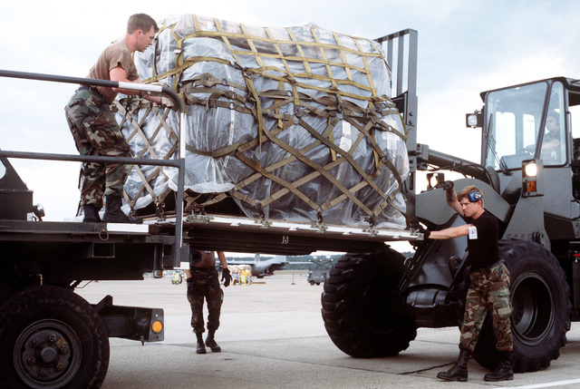 Members of the 314th Aerial Port Squadron move a pallet of cargo from a forklift onto a K-loader. The pallet will be loaded on a 314th Airlift Wing C-130 Hercules aircraft that is poarticipating in an operational readiness inspection (ORI) during Ocean Venture '92