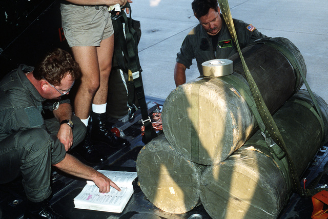 Members of the 8th Special Operations Squadron prepare a 1ST Special Operations Wing MC-130E Hercules Combat Talon aircraft for a Fulton recovery mission during the joint service exercise Ocean Venuture '92