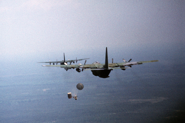 Pallets of supplies are dropped from 62nd Airlift Squadron C-130 Hercules aircraft. The 62nd is participating in an operational readiness inspection (ORI) and exercise Ocean Venture '92