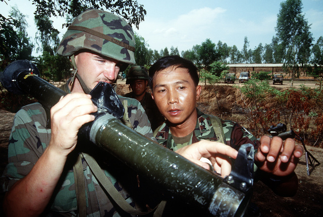PVT. Stephen Chesley, a member of the 1ST Battalion, 17th Regiment, 6th Infantry Division, demonstrates the operation of a Viper light anti-tank weapon to LT. COL. Apikit as part of a multiple integrated laser engagement system (MILES) equipment demonstration at Camp Friendship during the joint Thai-U.S. training exercise Cobra Gold '92