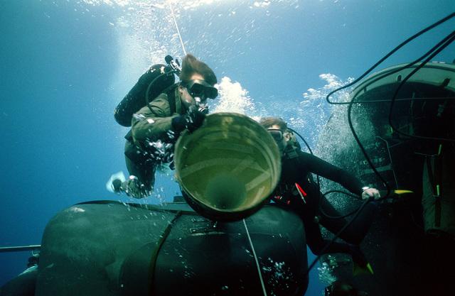 PH2(DV) David Tilton videotapes procedures as Sea-Air-Land