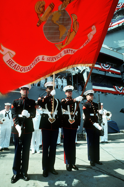 A U.S. Marine Corps color guard stands at attention during the commissioning of the guided missile cruiser USS ANZIO (CG-68)
