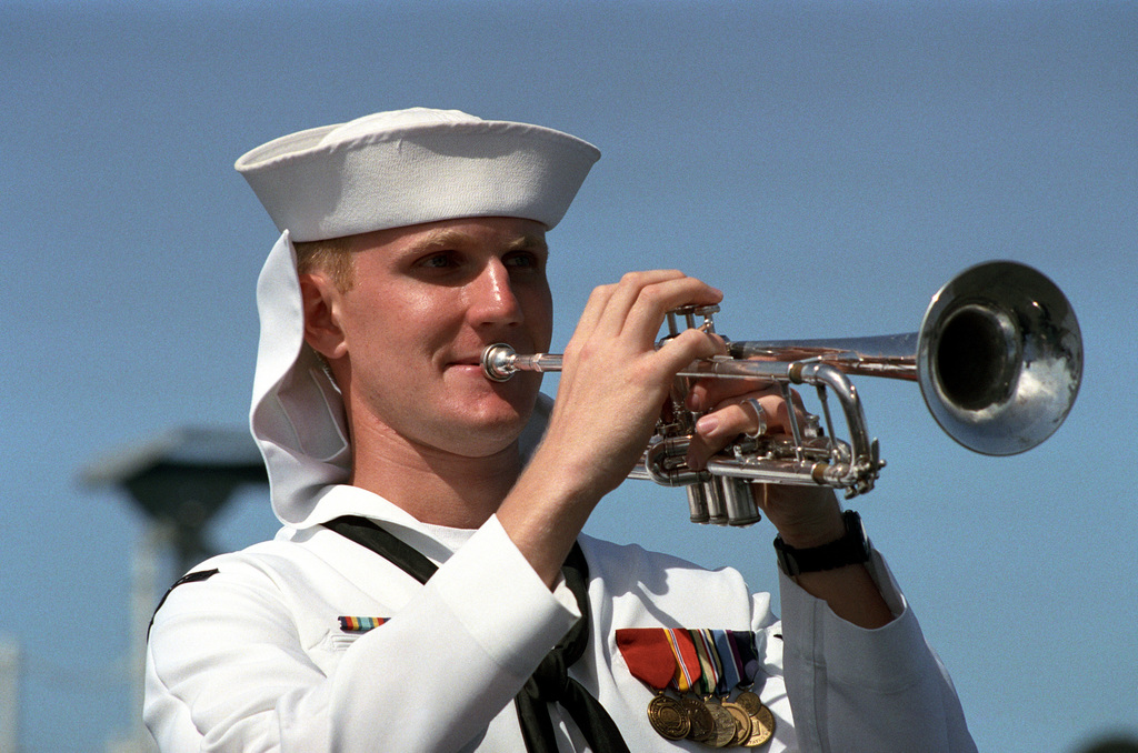 A bugler on board the U.S. Seventh Fleet flagship USS BLUE RIDGE (LCC-19) sounds TAPS at the conclusion of an ecumenical memorial service commemorating the 50th anniversary of the Battle of the Coral Sea