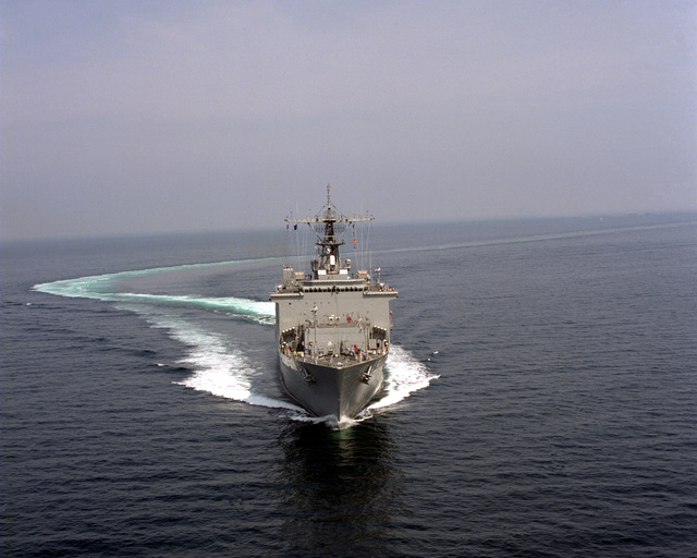 A bow view of the dock landing ship ASHLAND (LSD-48) underway after executing a high speed turn during sea trials