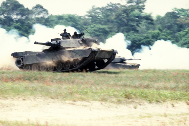 In a maneuver of speed and stability, with its 120mm main gun and special armor, a tank crew from the 2nd Tank Battalion, 2nd Marine Division demonstrates the M1A1 Abrams tank and its ability to close with and destroy the enemy on the integrated battlefield during Operation Ocean Venture 92