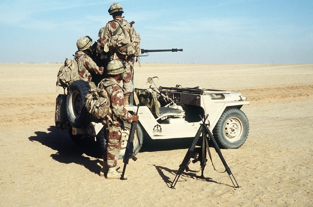 Soldiers of the 4th Brigade, Royal Saudi Land Force fire an M-2 .50-caliber machine gun mounted on the back of a M-151 light vehicle during an Operation Desert Shield capabilities demonstration. Stacked in the foreground are 7.62mm SAR-3 rifles.