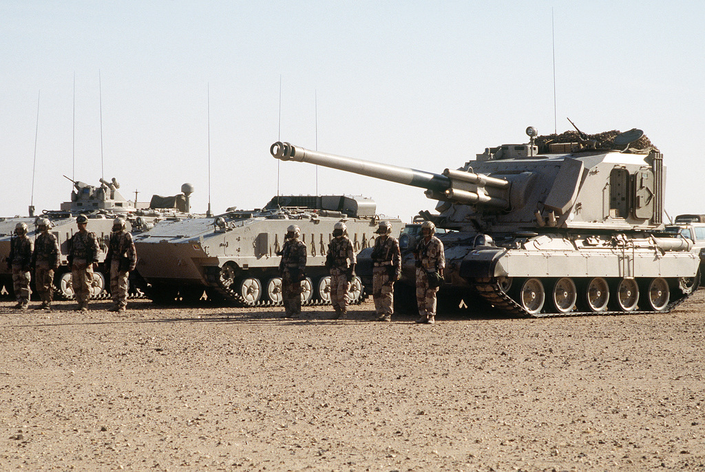 The 20th Brigade of the Royal Saudi Land Force displays a 155mm GCT self-propelled gun, left, and AMX-10P infantry combat vehicles during Operation Desert Shield.