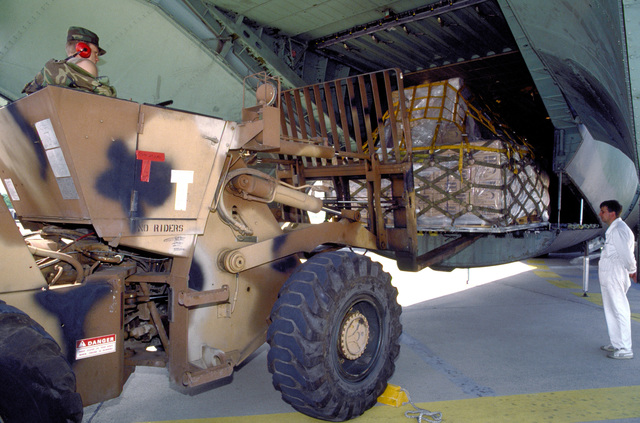 A crew member of the 4th Mobile Aerial Port Squadron uses an M-13K rough terrain forklift truck to unload pallets containing 50,000 ready-to-eat meals (MREs) from a C-141B Starlifter transport aircraft. Two Starlifters, one from the 437th Airlift Wing of Charleston Air Force Base, S.C., and another from the 63rd Airlift Wing of Norton Air Force Base, Calif., delivered the MREs to war-ravaged Croatia, and Norwegian United Nations forces personnel assisted in breaking down the pallets.