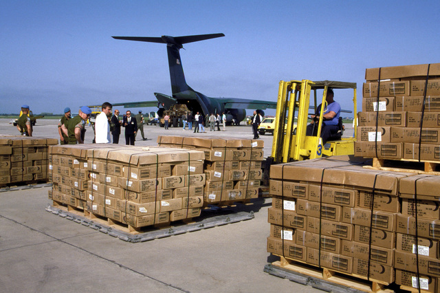 A forklift truck sets down pallets containing 50,000 ready-to-eat meals (MREs) as Norwegian United Nations forces personnel wait to break down the pallets. Two C-141B Starlifter aircraft, one from the 437th Airlift Wing of Charleston Air Force Base, S.C., and another from the 63rd Airlift Wing of Norton Air Force Base, Calif., delivered the MREs to war-ravaged Croatia.
