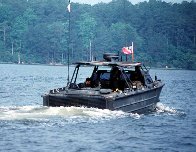 U.S. Marine Corps riverine assault craft RAC-55 patrols an inlet during a joint military training exercise called Ocean Venture '92. The RAC, used for drug interdiction and troop and fire support, has a Mark 19 40mm grenade launcher in the back and an M-2 .50-caliber machine gun mounted on the front
