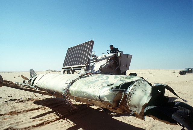 STAFF SGT. Stephen Olava of the 347th Transportation Squadron, Moody Air Force Base, Ga., operates an M-13K rough terrain forklift truck to transfer a Scud missile, shot down by an MIM-104 Patriot tactical air defense missile outside of Riyadh, to a flatbed trailer during Operation Desert Storm