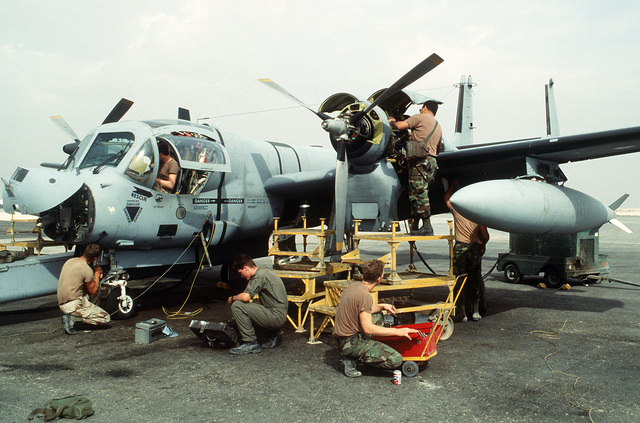 Maintenance crews work on an OV-1D Mohawk surveillance aircraft during Operation Desert Storm