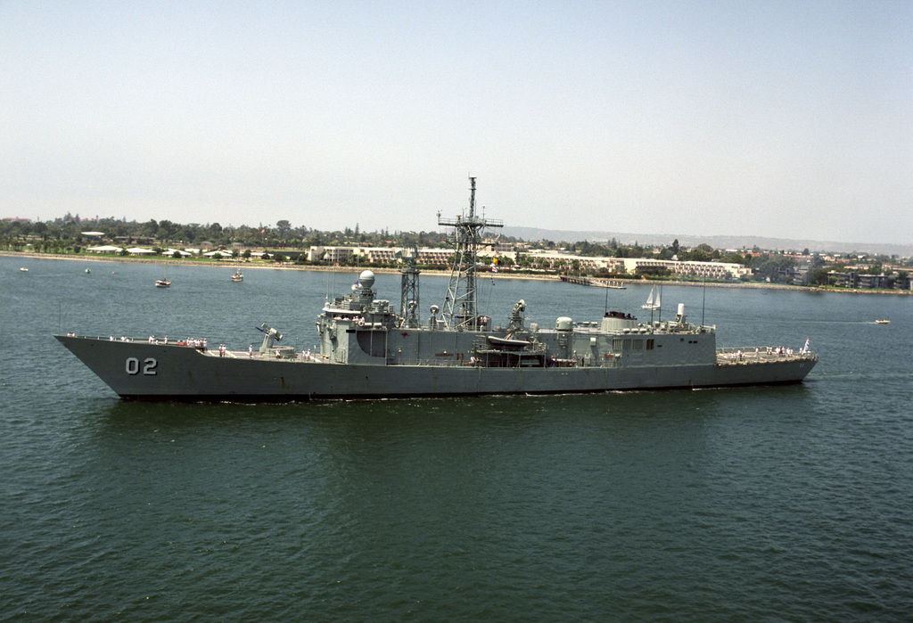 A port view of the Royal Australian Navy (RAN) Adelaide Class Guided Missile Frigate Her Majesty's Australian Ship (HMAS) CANBERRA (FFG 02), as she sails past the San Diego. The ship is participating in RIMPAC 92 (Rim of the Pacific Exercise 1992)