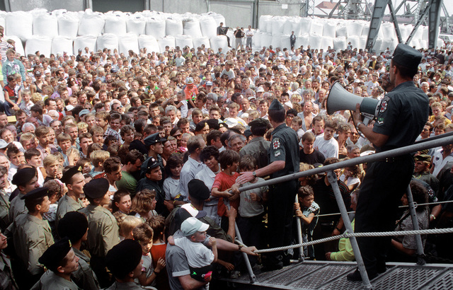 Policemen attempt to control the throng assembled at the gangway of the guided missile frigate USS HAWES (FFG-53). The HAWES also visited ports in Estonia and Lithuania after participating in BALTOPS '92. This was the first visit to these countries by a U.S. ship since 1924
