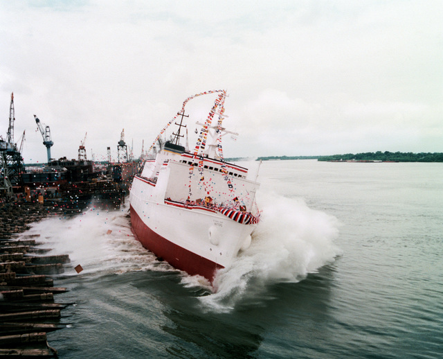 The surveying ship USNS WATERS (T-AGS-45) slips into the water at the Avondale Industries, Inc. shipyards just after being christened