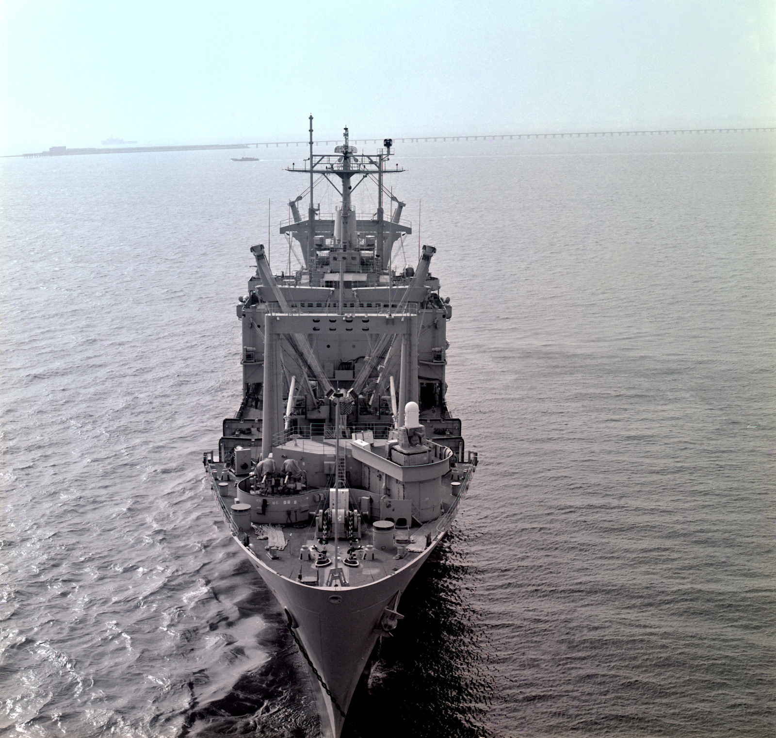 A bow view of the amphibious cargo ship USS EL PASO (LKA-117) at anchor off the Virginia Capes