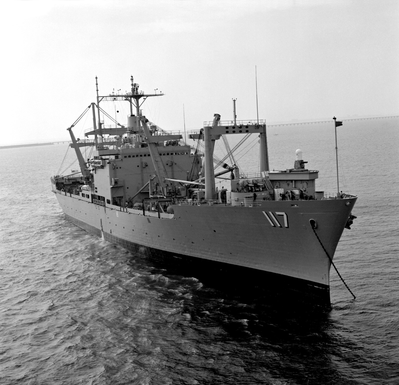 A starboard bow view of the amphibious cargo ship USS EL PASO (LKA-117) at anchor off the Virginia Capes
