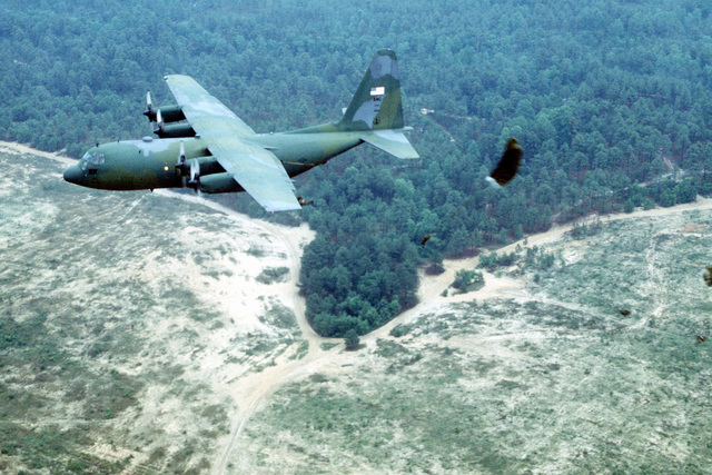 A C-130 Hercules from the 133rd Airlift Wing, Air National Guard, Minneapolis, Minn., dropping U.S. Army paratroopers during RODEO 92 airdrop competition