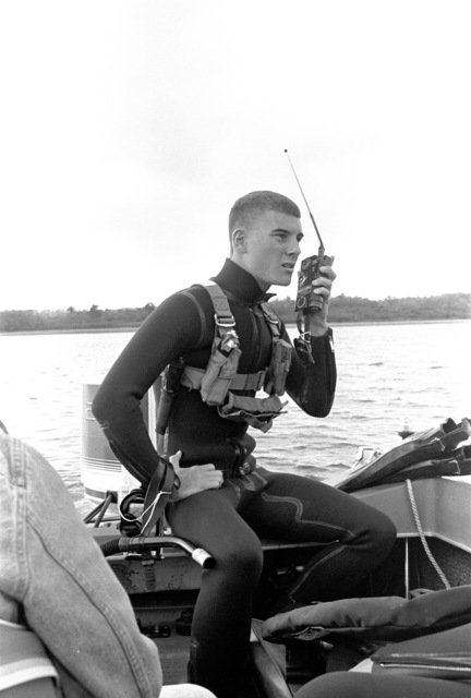 Aviation Anti-submarine Warfare Operator 2nd Class Chad Bruckshen of Helicopter Light Anti-submarine Squadron 94 (HSL-94), Naval Air Station, Willow Grove, Pa., uses a hand-held radio to contact the rescue helicopter from a safety boat during search and rescue training at Blue Marsh Lake