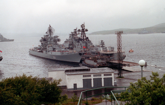 A Kresta II guided missile cruiser and a Udaloy class destroyer are moored to a pier during a port call by two American ships, the guided missile cruiser USS YORKTWON (CG-48) and the destroyer USS O'BANNON (DD-987), which are visitng the Severomorsk as part of an ongoing exchange between the navies of the United States and the Commonwealth of Independent States