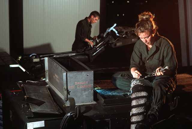 SENIOR AIRMAN Tammy Crofoot and AIRMAN 1ST Class David Rodenberger, mechanics in the 401st Maintenance Squadron, repair aerospace ground equipment that is part of the stock of war reserve materials damaged during Operation Desert Storm
