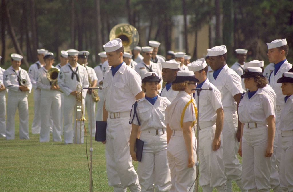 Members of a co-ed recruit company chorus stand in formation prior to a performance during their unit's graduation ceremony. Recruit Training Command, Orlando, is the only Navy command where both men and women undergo basic training