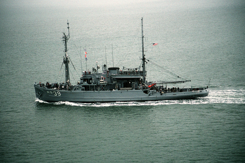 A port beam view of the salvage ship USS CONSERVER (ARS-39) underway