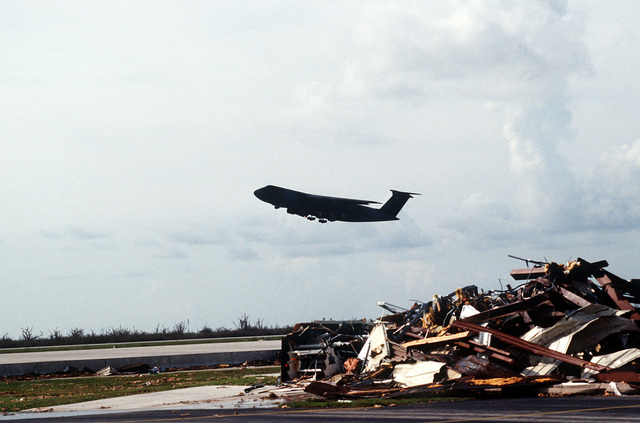 A C-5A Galaxy aircraft takes off after delivering relief supplies to the base, which was struck by Hurricane Andrew on August 24th