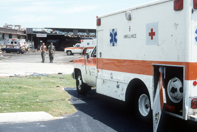A damaged ambulance is parked near the 31st Fighter Wing Hospital in the aftermath of Hurricane Andrew, which struck the area on August 24th