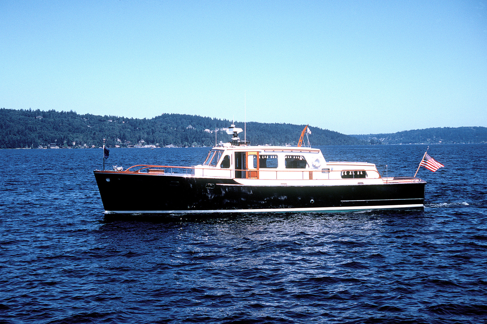 A starboard view of the flag officer's barge known as Old Man IV underway on Lake Washington during SEAFAIR '92