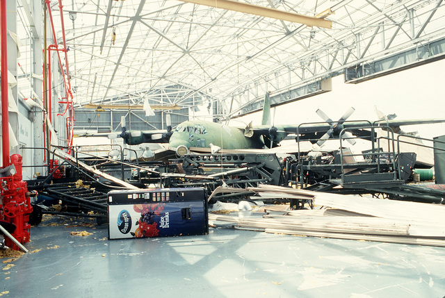 An AC-130 Hercules aircraft stands in a damaged hangar in the aftermath of Hurricane Andrew, which struck the area on August 24th