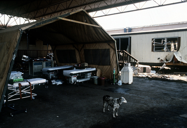 An emergency hospital is set up in a damaged hangar in the aftermath of Hurricane Andrew, which struck the area on August 24th