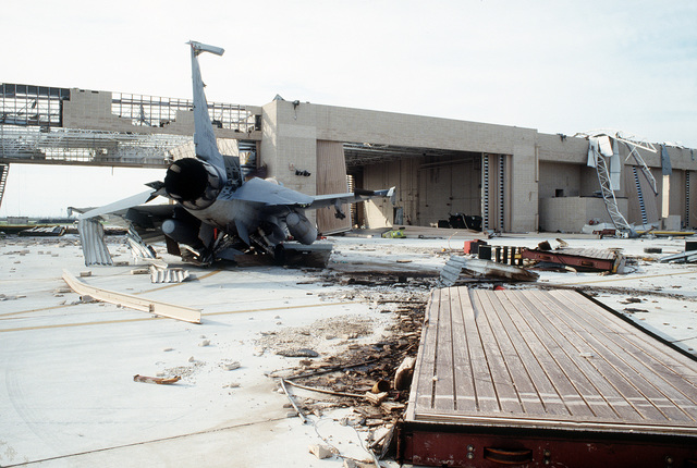 An F-16C Fighting Falcon aircraft lies in ruins in front of its hangar in the aftermath of Hurricane Andrew, which struck the area on August 24th