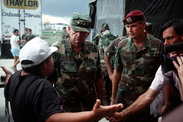 Army CHIEF of STAFF GEN. Gordon R. Sullivan and COL. L. Sullivan, 507th Task Force commander, converse with a Homestead relief volunteer outside Campbell Drive Middle School. Sullivan is in the region to inspect relief efforts set up for victims of Hurricane Andrew, which struck the region on August 24th