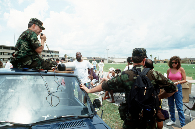 Base disaster personnel disseminate information about relief efforts to base residents in the aftermath of Hurricane Andrew, which struck the area on August 24th