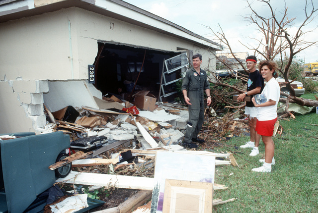 LT. COL. Fred VanValkenburg, 308th Fighter Squadron, and family members survey the damage to their on-base quarters in the aftermath of Hurricane Andrew, which struck the area on August 24th