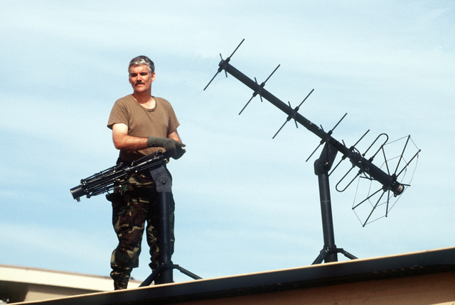 MASTER SGT. Glenn Parker, 438th Mobile Airlift Control Element Reaction Communications Squadron, erects satellite communications antennas in the aftermath of Hurricane Andrew cleanup efforts. The storm struck the area on August 24th