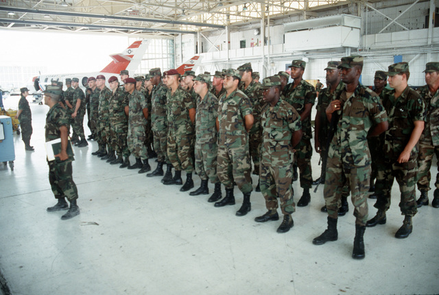 Members of the 55th Medical Group, 44th Medical Brigade, assemble in a hangar at Opa-Locka Coast Guard Air Station. The unit is in the area to assist residents in the aftermath of Hurricane Andrew, which struck the region on August 24th