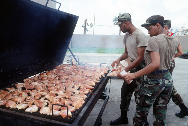 Mess management personnel from Seymour Johnson Air Force Base, N.C. grill a large quantity of chickens to feed base relief workers in the aftermath of Hurricane Andrew. The storm struck the area on August 24th