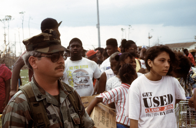 Mess Management SPECIALIST 1ST Class Bryan I. Schlay provides security at the Florida City Park supply distribution point, set up to aid victims of Hurricane Andrew, which struck the area on August 24th