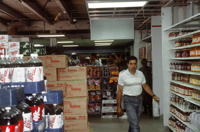 Military personnel shop in the temporary base exchange facility, set up after the regular exchange was destroyed by Hurricane Andrew, which struck the region on August 24th