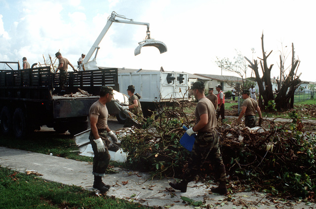 National Guardsmen clean up debris in the aftermath of Hurricane Andrew, which struck the area on August 24th