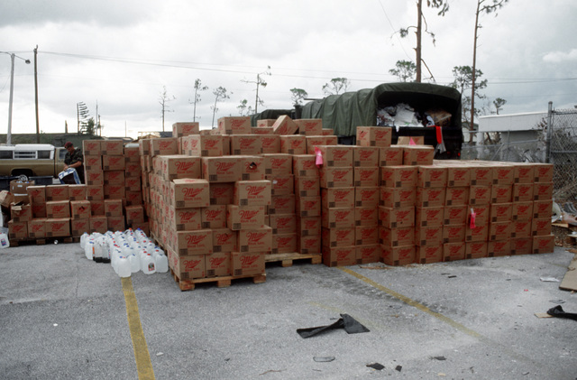 Relief supplies are stacked outside Colonial Drive Elementary School in the aftermath of Hurricane Andrew, which struck the area on August 24th