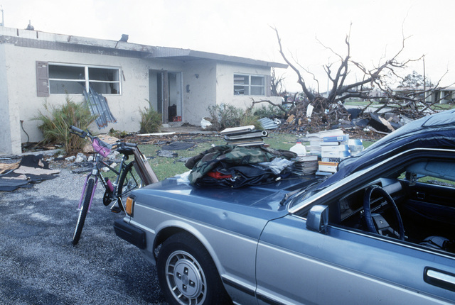Salvaged personal belongings are stacked on a car hood in the aftermath of Hurricane Andrew, which struck the area on August 24th