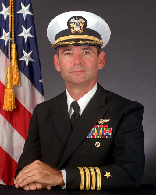 CAPT Daniel M. Hacker, USN (covered)