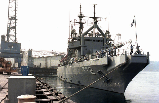 The salvage and rescue ship USS BEAUFORT (ATS-2) is moored to a pier prior to towing a dry dock from Naval Station, Subic Bay, which is preparing closure. Following the U.S. Navy's evacuation, the Subic Bay Metropolitan Authority will assume control of the area